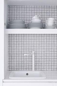 Décor inspiration#kitchen #splashback #tiles - small ceramic square tiles in neutral colour creating depth into the sink space