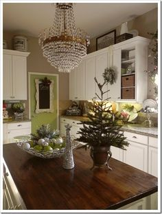 antique feel + evergeen on island in kitchen