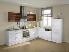 two-tone kitchen cabinets will reinsure your favorite spot in the . with it's dark wood cabinets on the bottom and the ultra modern white pieces on top. Two Tone Kitchen Cabinets, Dark Wood Cabinets, Cool Kitchens, Small Kitchens, White Kitchens, Modern Kitchens, Kitchen Pictures, Kitchen Ideas, Updated Kitchen