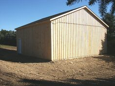 This low roof pitch Pole Barn is built with roof slope as a more affordable option. Low Pitch, Farms Living, Garage Doors, Shed, Barn, Outdoor Structures, Building, Outdoor Decor, Image