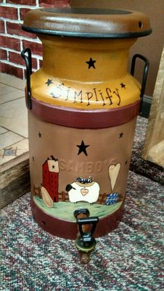"""Primitive hand painted milk can.  Stands about 20"""" tall."""