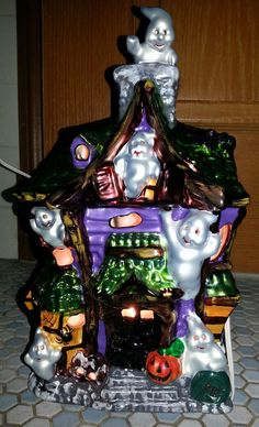 "For Halloween collectors and Christopher Radko Enthusiasts... Check out this vintage Radko Holiday Celebrations Ghost Manor. It's a 12"" tall Electrical lighted Ceramic Haunted Manor that was made for Target Stores many years ago. Very cool and for sale. :)"