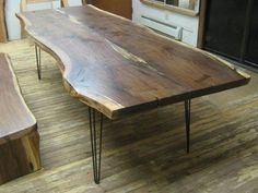 Walnut live edge slab table with hairpin legs. [beautiful slice of tree but those legs are a complete failure.  They don't deserve to be attached to such an amazing piece of wood.]