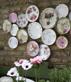 I must collect tea cups and china like these for the girls' walls when I redo their room.  I am thinking shabby chic tea room/cottage!