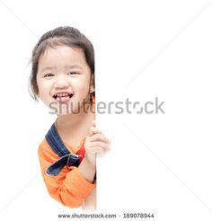 Isolated asian girl holding blank board - stock photo