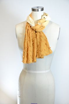 Really cool scarf technique:  1. Place scarf on back of neck, ends front, with one end a lot longer.  2. Wrap long end around neck.  3. Take long end, push it under loop around neck, then take end and pull through small opening created.  4. Pull tight and repeat 3-4x to create braid.