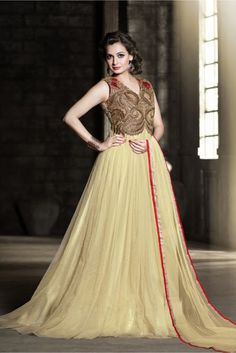 Cream Colour Net Fabric Designer Semi Stitched Gown Comes With Matching Dupatta. This Gown Is Crafted With Resham Work,Embroidery Work. This Gown Comes As a Semi Stitched So It Can Be Stitched Up To S...
