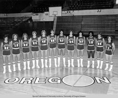Black and white photo of the players of the 1979-80 University of Oregon women's basketball team taken at McArthur Court. From left to right: Suzanne Washington, Debbie Ware, Beth Busby, Bev Smith, Kris Luedloff, Joni Martin, Claudia Eaton, Meg Jones, Mary Ann Stoican, Debbie Adams, Julie Cushing, and Allison Towriss. ©University of Oregon Libraries - Special Collections and University Archives