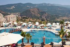 4★ Kusadasi Golf & Spa Resort, #Turkey. Eleven swimming pools ✔ Voted 4/5 on #TripAdvisor ✔ Three a la carte restaurants, three pool bars and an ice cream parlour on site ✔ International golf course next door with beautiful views across the rolling countryside ✔ Right now you can get of all this All Inclusive indulgence from just £312pp!