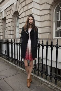 A moto-style coat toughened up a little day dress and ankle boots.                  Source: Getty / Kirstin Sinclair