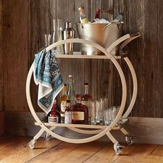 Popular on Pinterest: our Asher 2-Tier Rolling Bar Cart. Set up your home bar in the corner, by the sofa, or move it around the room to serve guests. (link in profile to #shop) #WorldMarket #homedecor #barcart