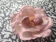 Hey, I found this really awesome Etsy listing at https://www.etsy.com/listing/163612319/fondant-baby-girl-on-edible-flower-cake