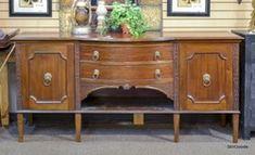 Mahogany sideboard buffet with 2 drawers, 2 doors, interior shelf.