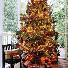 Want a designer look for your holiday tree? Browse our best tips for better Christmas tree decor that you can easily do yourself! Christmas Tree Pictures, Pretty Christmas Trees, Colorful Christmas Tree, Christmas Tree Themes, Noel Christmas, Holiday Tree, Christmas Tree Toppers, Christmas Traditions, Beautiful Christmas