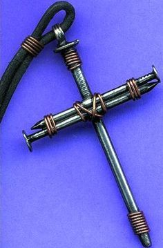cross necklace craft. I have made one of these out of masonary/concrete nails and hang it on our tree every year