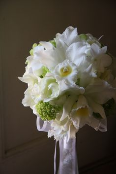 Stunning orchid and rose wedding bouquet