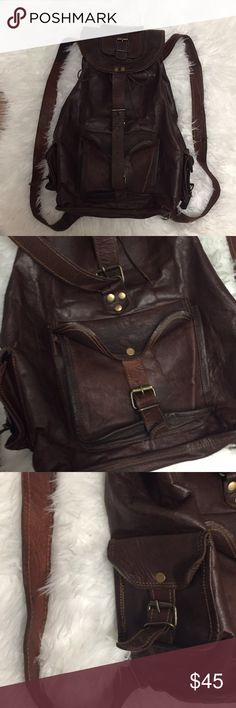 Vintage Leather Backpack Awesome dark brown leather vintage full size backpack. Ties closed with a leather string under the main flap. Really roomy and can fit a ton of stuff. Has several pockets on the exterior to store your stuff and also has a zip pocket on the inside. Great vintage condition, leather has some minor wear from use but no rips or stains. Great backpack for festivals, camping, traveling, or whatever adventures you get yourself into! Vintage Bags Backpacks
