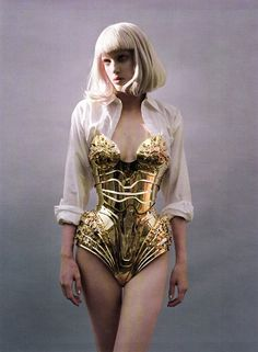 A piece of Modern Art, like something from a Star Wars movie...Thierry Mugler Gold Armour Plated Corset. I love the way it has been styled so casually with the masculine white suit shirt. A truly magnificent image!