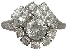 With such a unique design this Vintage 2.67Ct Diamond, Platinum Cluster Ring is absolutely stunning!