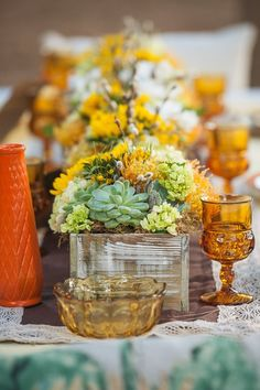 #fallweddingideas using succulents and amber glass. See the whole day here http://www.weddingchicks.com/2015/09/16/country-sunflower-wedding-inspiration/