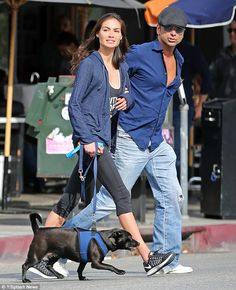 New love: John Stamos was pictured enjoying a romantic lunch date with his new girlfriend Caitlin McHugh in West Hollywood on Thursday