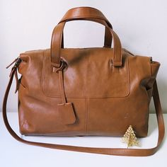 "F21 Faux Leather Weekender Bag Brown Faux Leather Weekender Bag  Very Stylish and just the right size for quick getaways. Features two top handles, a detachable shoulder strap, roomy interior and three patch pockets for organization.  -Fully lined, Midweight -Detachable strap measures 44.5"" -Shell: 100% polyurethane; Lining: 100% polyester -12"" height x 18"" width x 6.7"" depth -Imported  *Minor flaws see pic 4 [top]*  NO TRADES.. SORRY  OFFERS WELCOME  Forever 21 Bags Travel Bags"