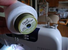 What a brilliant idea! Insert sewing thread spool into cone thread to make it fit sewing machine.