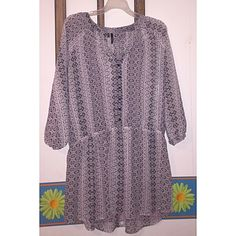 """MAURICES patterned sheer tunic Is a true XXL. Is NWT. Has never been worn or washed. Has 3/4 length sleeves with elastic at the ends of them. And has a thin elastic band around the waistline. I am 5'7"""" and it covers my butt in the back. The colors are like a white, dark/light grey. Maurices Tops Tunics"""