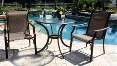 Chub Cay Patio 3 Piece Bistro Set by Hospitality Rattan. $618.80. Finished in a powder coated Dark Bronze finish. Weather and UV resistant. Made of Extruded Aluminum Frame will not rust w Twitchel fiber. Includes tempered hammered glass with umbrella hole. Include: Two Armchairs and Round Table. 3 PC SET-920-D Features: -Weather and UV resistant.-Sturdy aluminum legs for extra support. Includes: -Set includes two arm chairs and 36'' round table.-Includes tempered hammere...