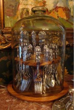 Perfect way to display antique silverware, and store it dust free!