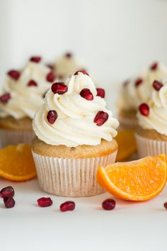Orange Pomegranate Cupcakes are stuffed with a pomegranate spread and topped with orange vanilla buttercream frosting to create the freshest flavors!