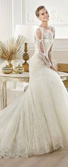 Pronvias Lace Wedding Gown...very regal! This gown will surely make any woman feel like a princess, a queen even :-)