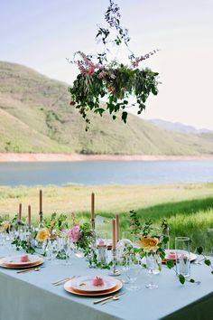 Summer tablescape and floral chandelier by Sarah Winward.