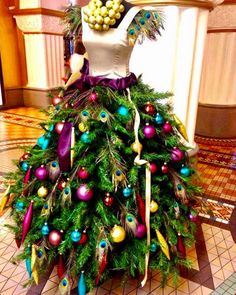 Forget the Ugly Christmas Sweater. I'm gonna rock a whole Ugly Christmas Ball Gown! 7 ways Florists use Mannequins for Fashion Forward Xmas Decor Mannequin Christmas Tree, Dress Form Christmas Tree, Noel Christmas, Christmas Fashion, Christmas Dresses, Peacock Christmas Tree, Holiday Tree, Christmas Skirt, Black Christmas