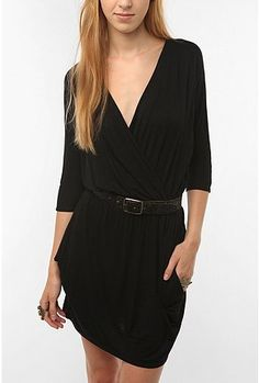 Talk about a simple black dress! Im diggin the deep v neck and belt. its simple, classy and i can imagine you can dress this up, but also keep it casual. (my kind of style! :) )
