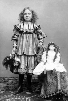 Found this pinned as a post-mortem girl with doll, but I she was, obviously, very much alive. If there is a posting stand behind her, it was merely used to help her hold the pose and keep still during the long exposure time that was required back then. Vintage Family Photos, Vintage Children Photos, Vintage Girls, Vintage Pictures, Vintage Images, Vintage Dresses, Vintage Outfits, Victorian Photos, Antique Photos