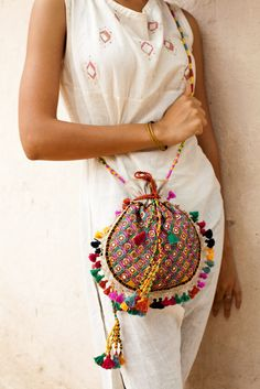 Beautiful Potli bag: It is a creation of the women who work in Kalaraksha, ., Beautiful Potli bag: It is the brainchild of women who work at Kalaraksha, a Kachchh NGO. The bag is fully embroidered by hand with Rabari mirror work. My Bags, Purses And Bags, Potli Bags, Ethnic Bag, Embroidery Bags, Boho Bags, Hippie Bags, Beautiful Bags, Beautiful Beautiful