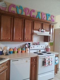 i love the cup cake kitchen decor if its not to much. i think this here would be perfect without the capitals words up top and the thing above the oven fan. without those it would be just enough