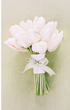 White Tulip Bouquet - Read more on One Fab Day: http://onefabday.com/one-flower-bridal-bouquets/