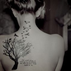 Idk what it says but I love the tree and birds.