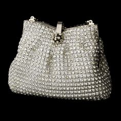 The Glamorous Swarovski Crystal Evening Bag is a vintage-inspired evening bag that will add a romantic and glamorous touch to your special day. http://www.elegantbridalhairaccessories.com/shop/bridal-handbags-purses/glamorous-swarovski-crystal-evening-bag/