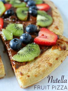 Super yummy summer dessert! Nutella fruit pizza with a cinnamon sugar crust. Quick and easy to make!