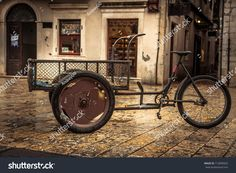https://image.shutterstock.com/z/stock-photo-retro-bicycle-on-vintage-europe-medieval-plaza-with-stone-pavement-in-overcast-day-during-raining-712899502.jpg