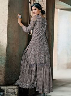 Grey Glam Multi Embroidered Flared Gharara Suit features very intrinsic designer embroidery over its soft net top paired with matching layered daman embroidered net gharara bottom and bordered nazm. Pakistani Bridal Dresses, Indian Dresses, Indian Outfits, Pakistani Suit With Pants, Pakistani Suits, Sharara Designs, Kurti Designs Party Wear, Indian Attire, Indian Wear