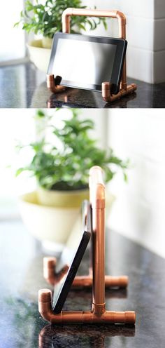 Oh my goodness, this copper pipe DIY tablet holder was so stinkin' easy to make, and not nearly as expensive as I thought it would be, either. I was shopping at Home Depot last week, and this lovely gentleman showed me how easy it is to cut copper pipe. Industrial Paper Towel Holders, Pipe Furniture, Furniture Vintage, Industrial Furniture, Furniture Design, Industrial Lamps, Orb Pendant Light, Industrial Farmhouse, Vintage Industrial