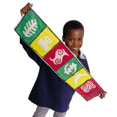 Adire Cloth- African cloth with symbols that stand for character traits we aim to teach- perseverance, courage, independence...