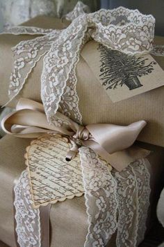Brown paper, home made labels, all tied up with lace or silk ribbon.