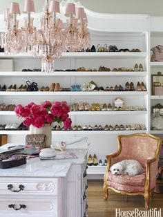 """Braheler's carpenter """"stretched"""" a vintage armoire to hold shoes. The Belle Epoque chandelier casts a rosy glow over an island cobbled together from multiple cabinets.   Designer Annie Brahler, House Beautiful May 2012 - By Douglas Brenner,  Photo: Bjorn Wallander."""