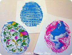 Print making Easter eggs using an oil cloth