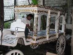 funeral carriage  traditional funeral carriage in white, gold and silver leaf to be pulled by horses